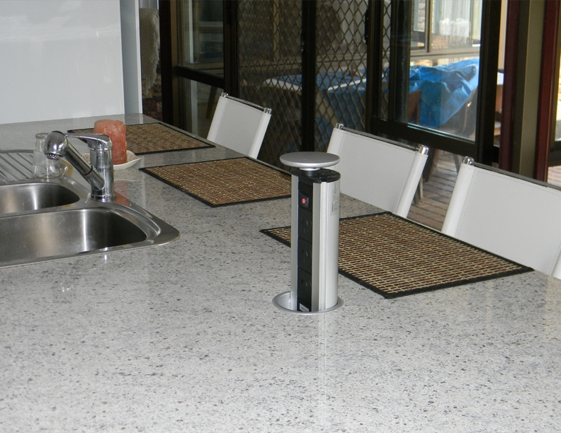 Kitchen bench with pop up power points