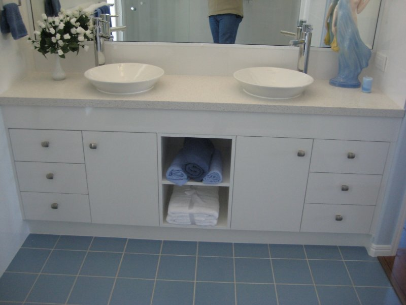 Blue and White Ensuite With Double Bowls